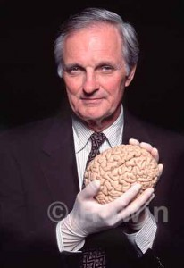 Photo of Alan Alda holding a human brain
